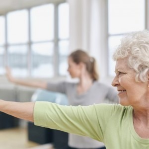 An elderly woman exercising