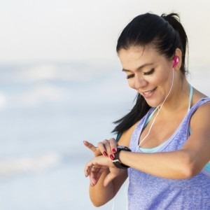 Woman looking at a fitness tracker on her wrist