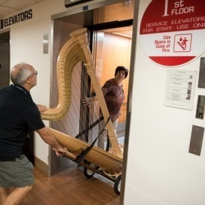 Image of a harp being loaded onto the elevator. The Florida Orchestra stopped at Tampa General Hospital this morning on their community performances tour