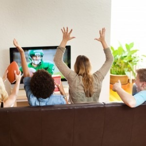 Group of people watching football