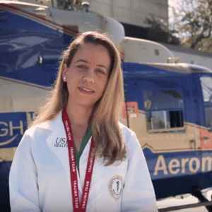 Female physician in front of a helicopter