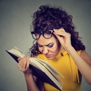 Woman trying to read without her glasses