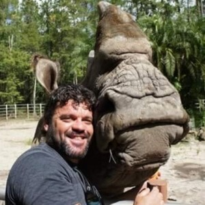Man hugging a rhino