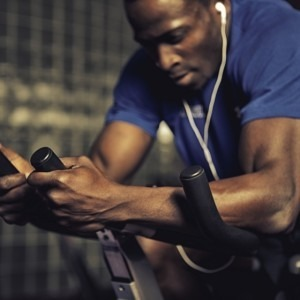 Man working out on a spinning bike