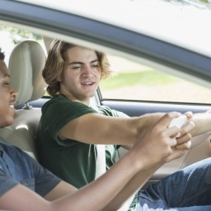 Teen boys distracted by a cell phone while driving