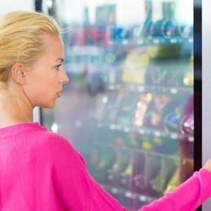 Woman using a vending machine
