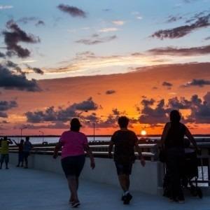People walking during sunset
