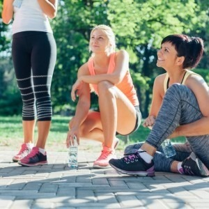 A group of women taking a break from exercising