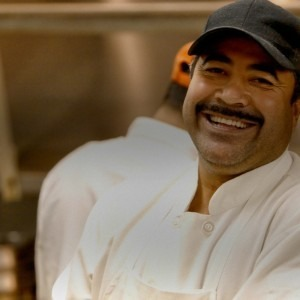 A cook smiling