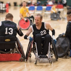 Three men participating in wheelchair rugby