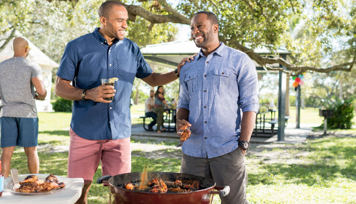 Men hanging out at a cook out