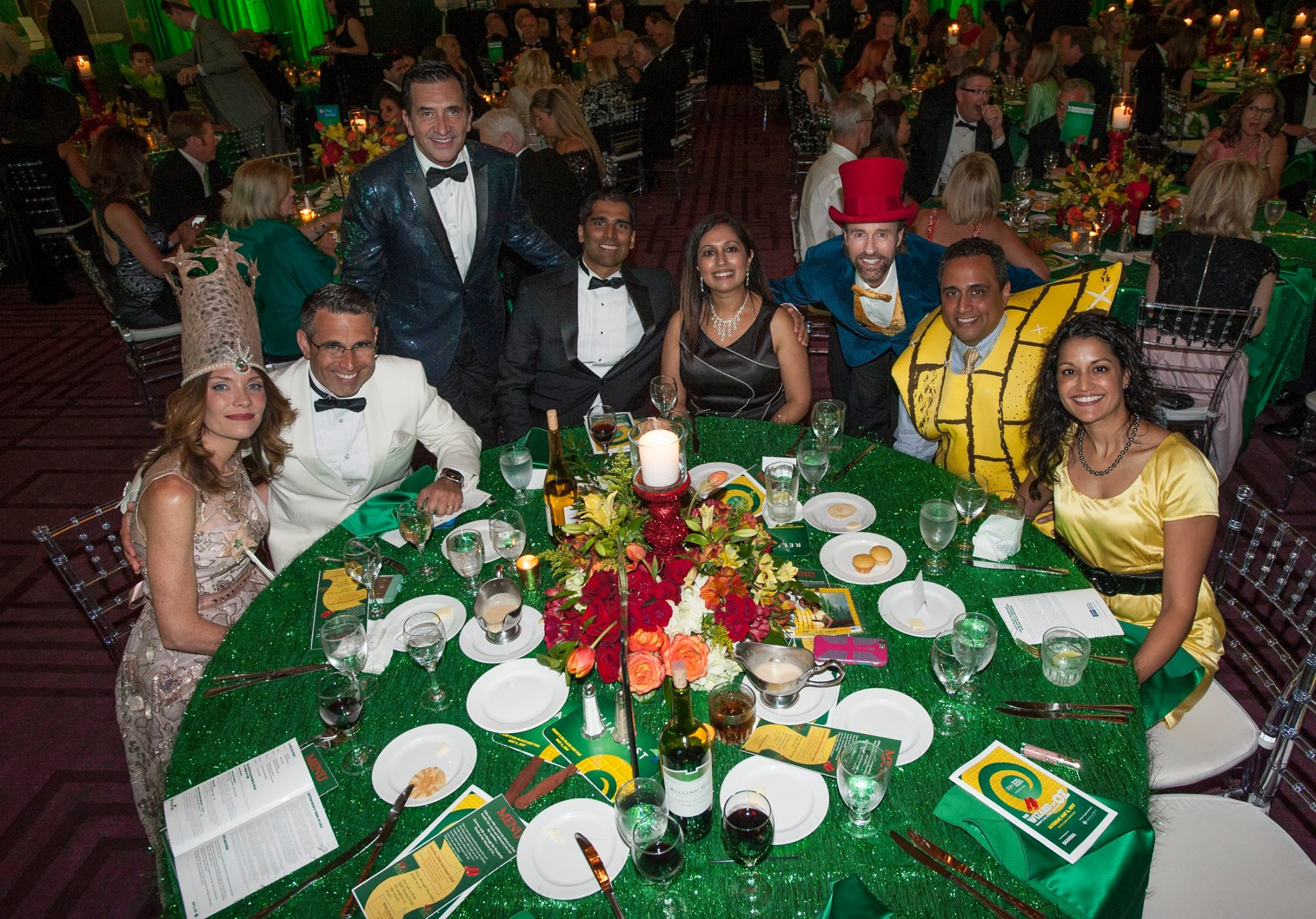 TGH Foundation Wizard of Oz gala table group photo.