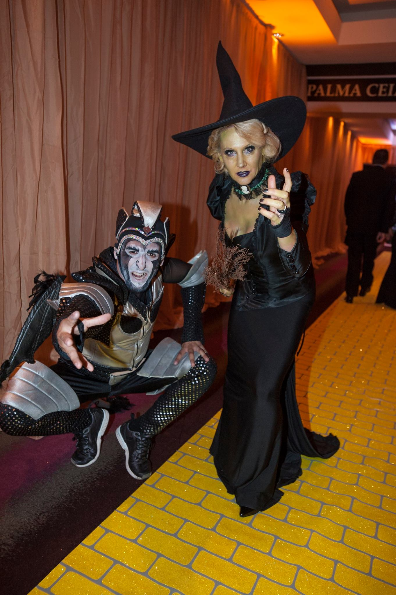 The Wicked Witch of the West and her monkey at the Wizard of Oz gala