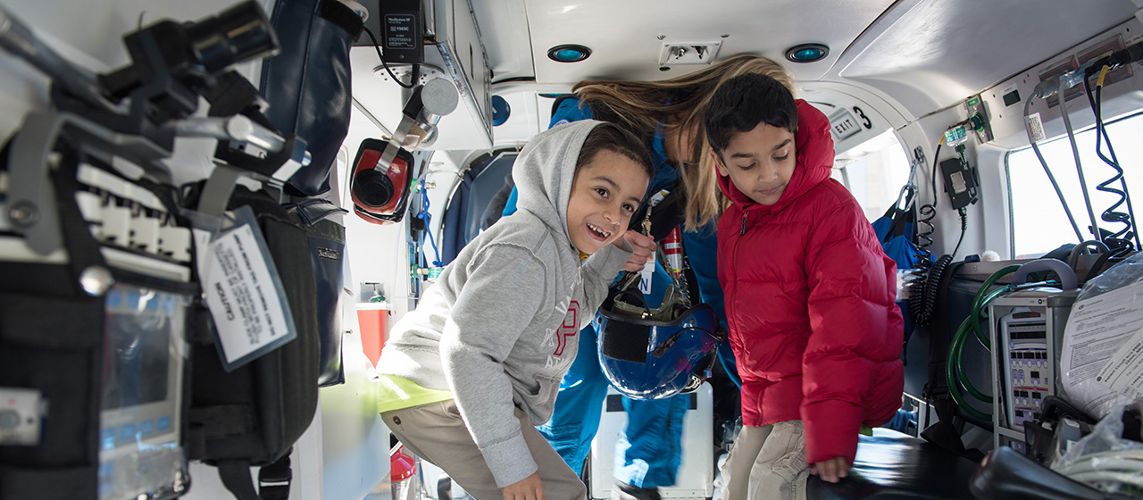 Children taking a tour of emergency helicopter