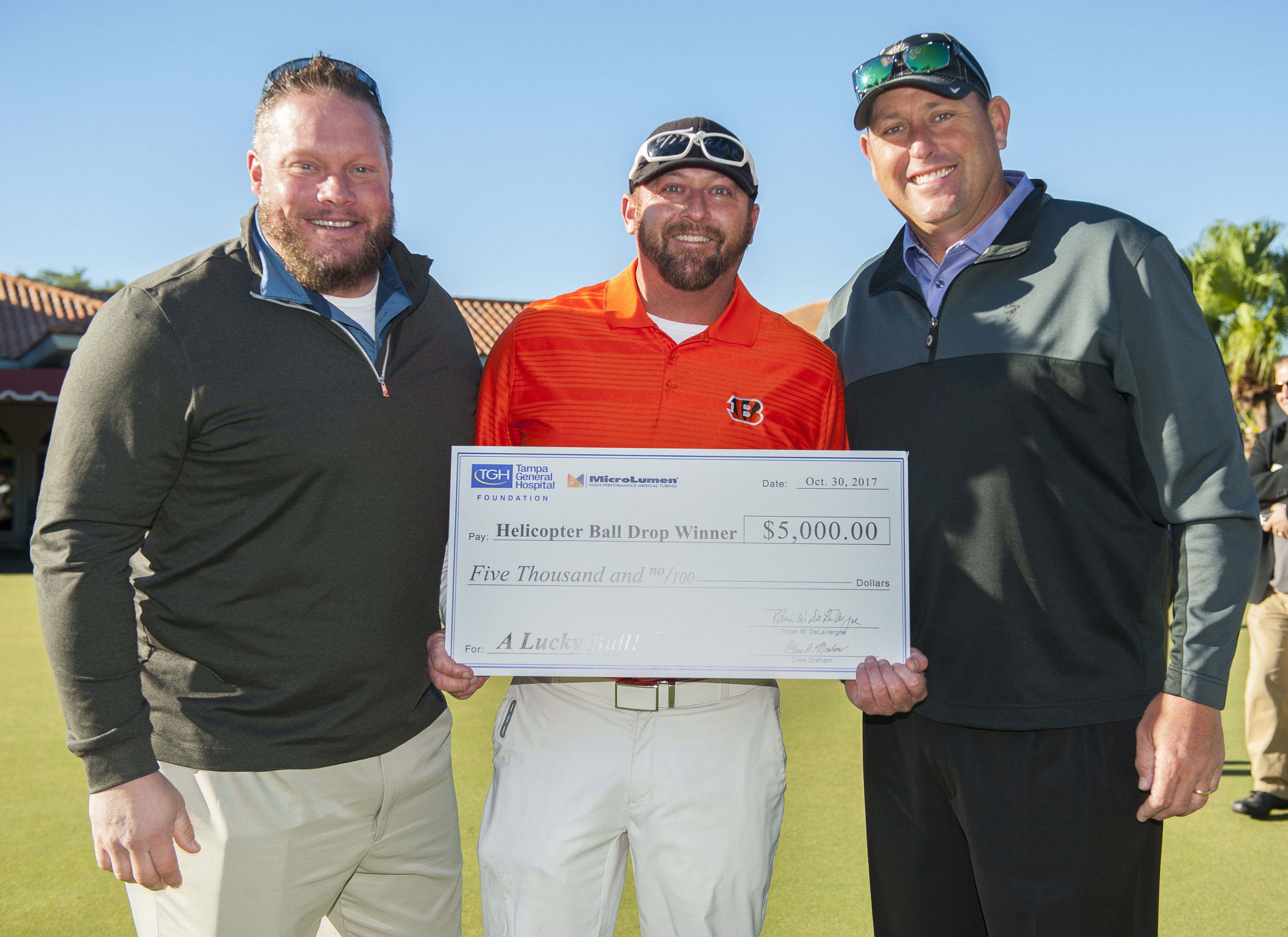 Helicopter Ball Drop winner, Jason Rabold, with golf tournament co-chairs, Brandon Day and Danny Jackson.