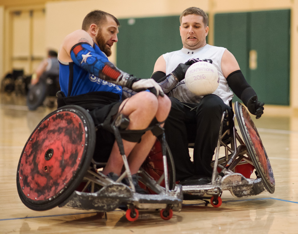 Two men particiapting in wheelchair rugby