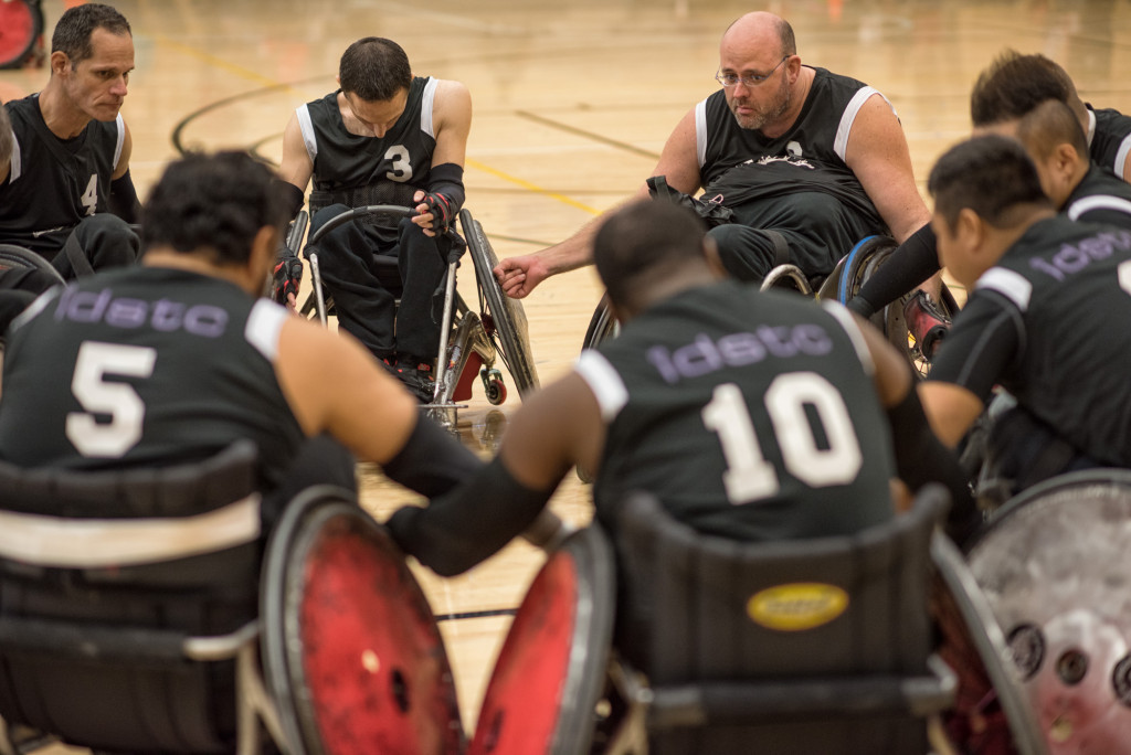 A group of men participating in wheelchair rugby