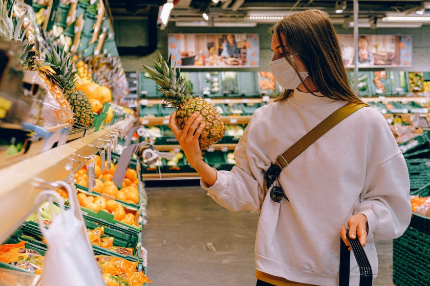 Woman wearing a mask at the grocery store